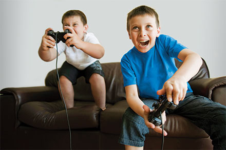 Kids playing video games together
