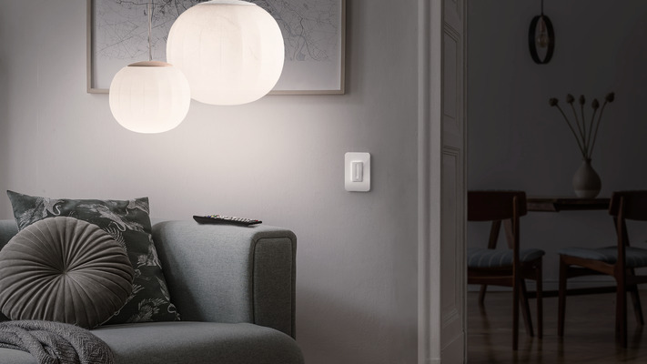 Wemo WiFi Smart Dimmer shown in living room with dimmed lighting